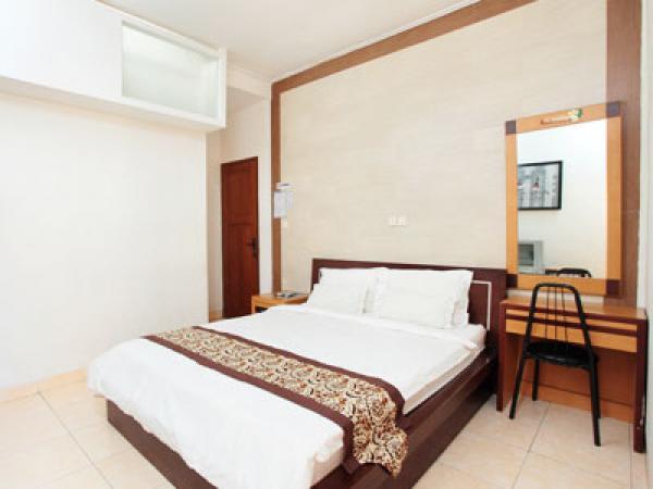 de' Tropis Family Guest House Kamar Tidur